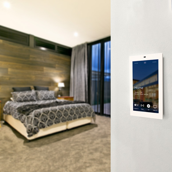 Savant touch screen on wall in bedroom